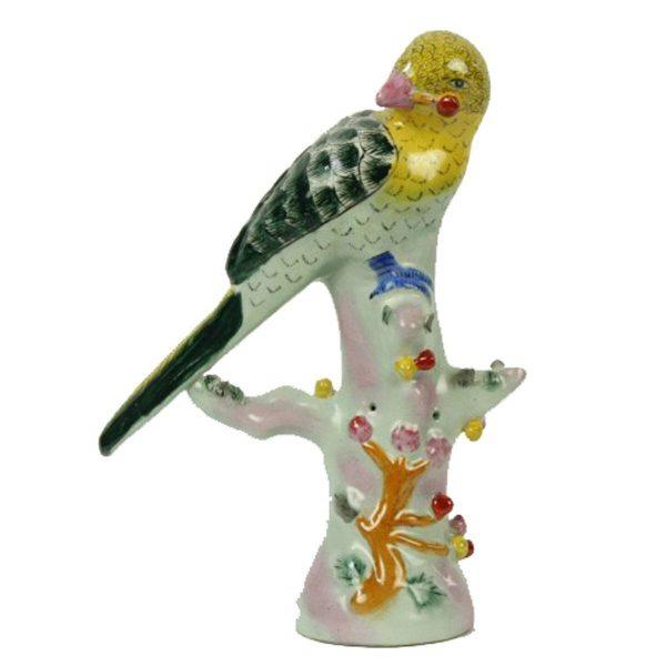 Porseleinen beeld links kijkende vogel