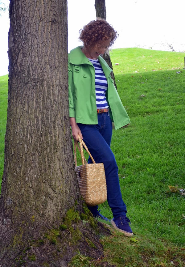 wearing jeans with a green jacket | 40plusstyle.com