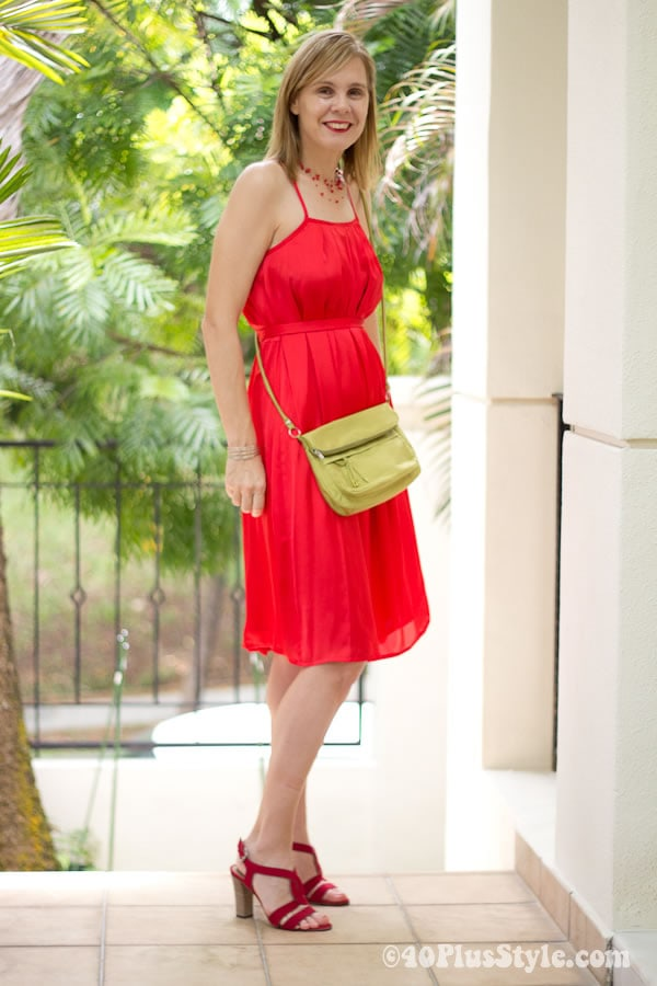 wearing a red dress with a pop of lime green | 40plusstyle.com