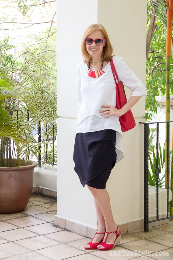 Black skirt with a white asymmetrical top | 40plusstyle.com