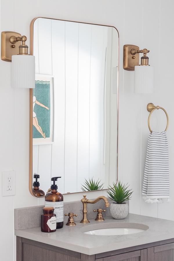 Coastal Bathroom wood vanity gray tile white paneled walls