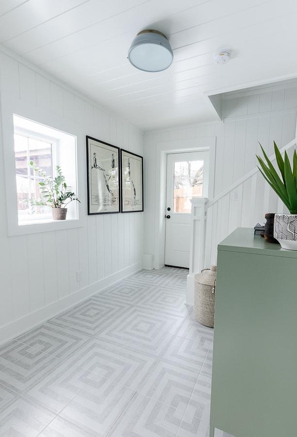 white paneled walls grey patterned floor tile pool house mudroom