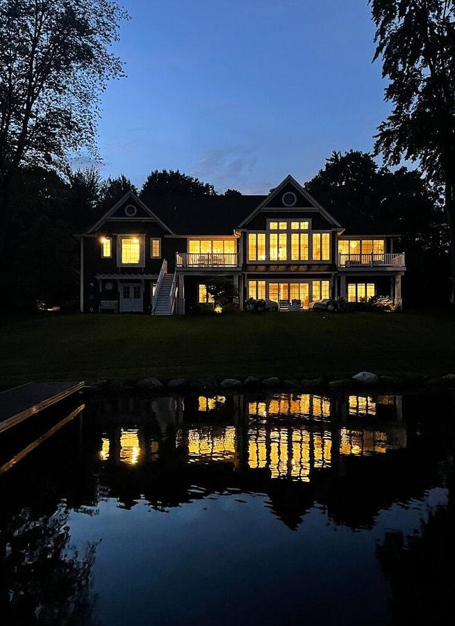 night time lake house