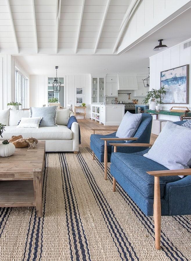 lake house living room blue green and white decor. striped jute rug