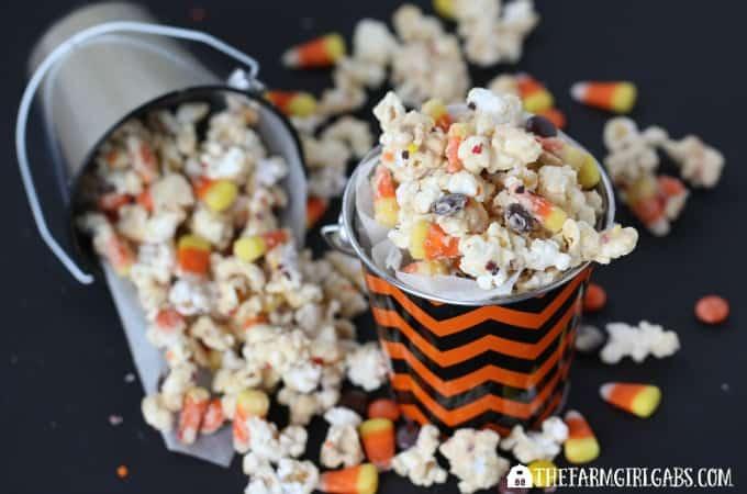 This Candy Corn Popcorn recipe is the perfect Halloween snack.   www.thefarmgirlgabs.com