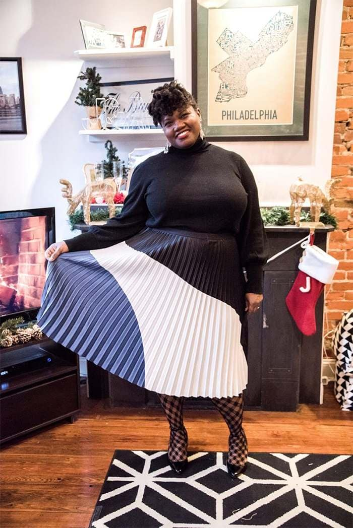 Georgette from Grown and Curvy Women is wearing Black Sweatshirt and Pleated Skirt | fashion over 40 | 40plusstyle