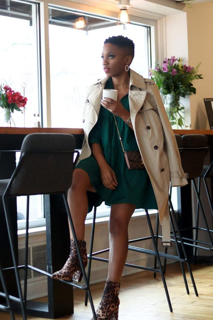 A green dress worn with a beige trench coat | 40plusstyle.com
