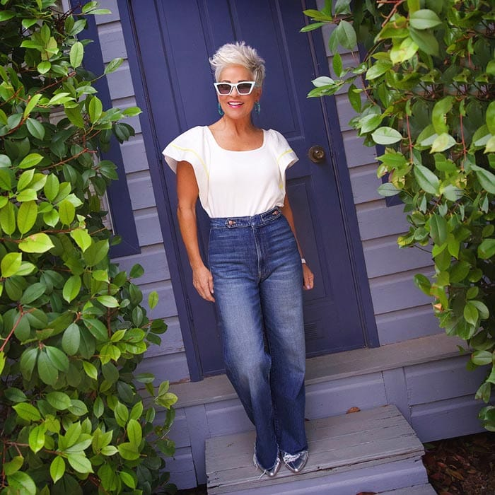 Shauna wearing flounce sleeve top and jeans | 40plusstyle.com