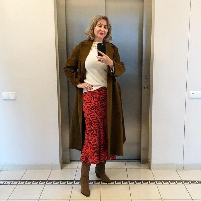 the best winter coats for women - Renata wears a long brown coat | 40plusstyle.com