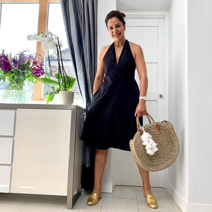 Anita wearing a black halterneck dress | 40plusstyle.com