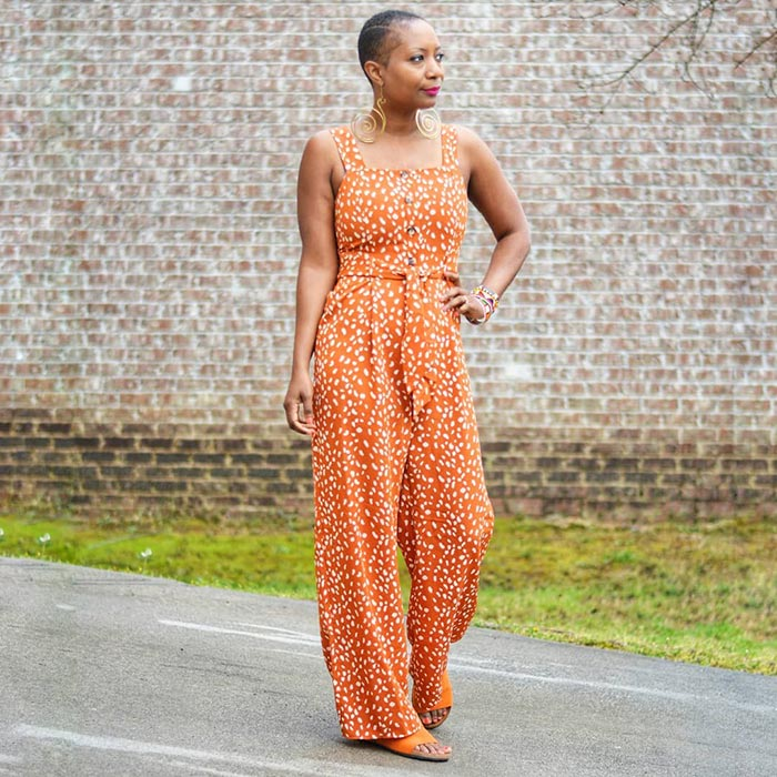 Summer jumpsuits for women - Troy wears an orange and white jumpsuit | 40plusstyle.com