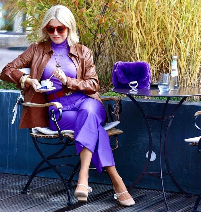 Petra wearing purple pants and a matching top | 40plusstyle.com