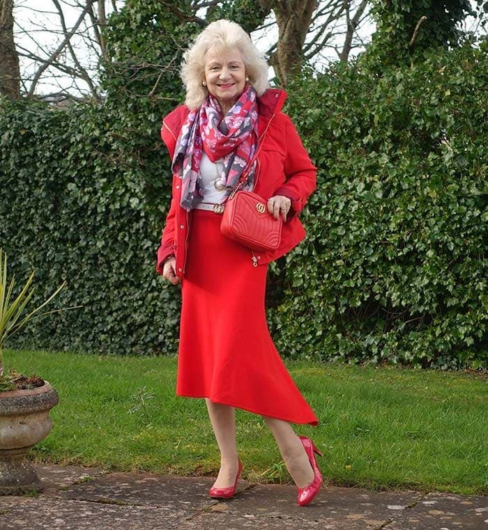 Jo wears an all-red outfit | 40plusstyle.com