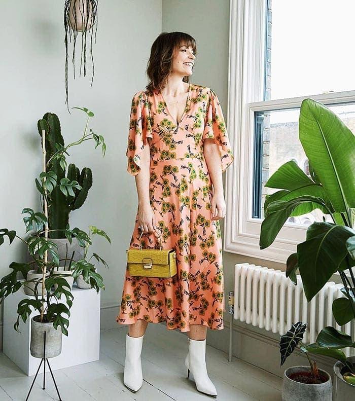 Lizzi wears a floral dress   40plusstyle.com