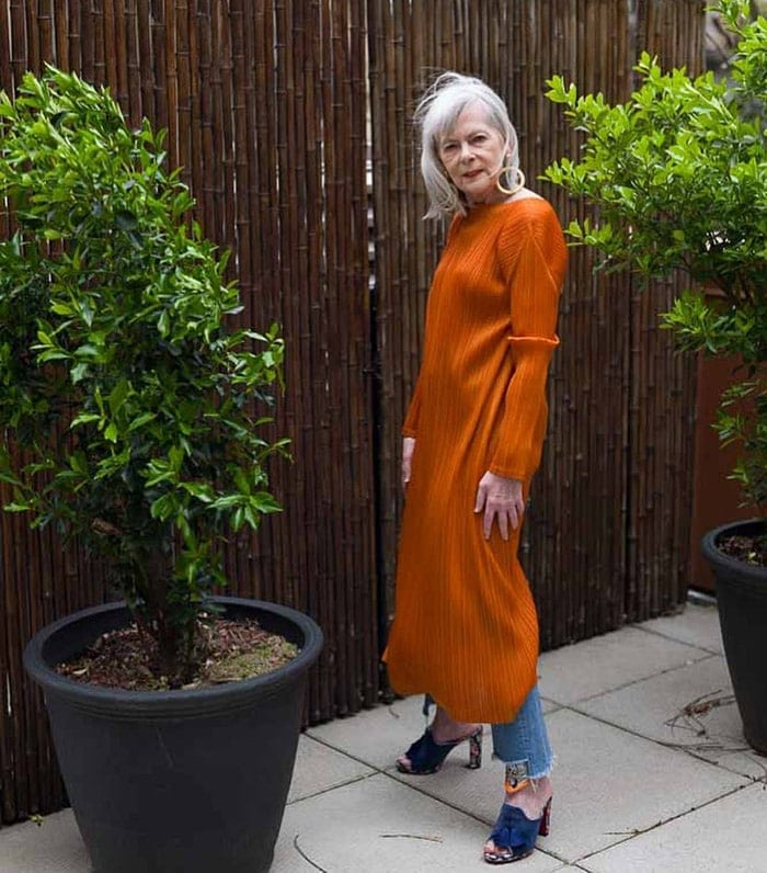 Dresses with pants - Lyn wearing a long dress with jeans   40plusstyle.com