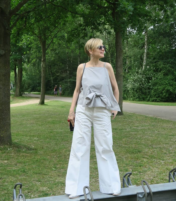 Sylvia wearing white flared pants | 40plusstyle.com