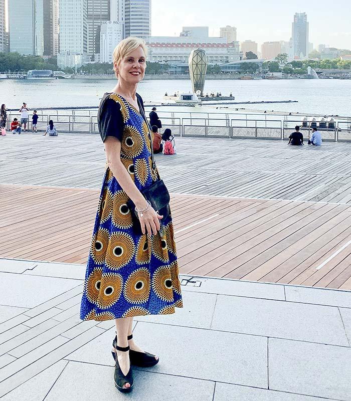 how to dress over 40 - Sylvia wears a print dress | 40plusstyle.com
