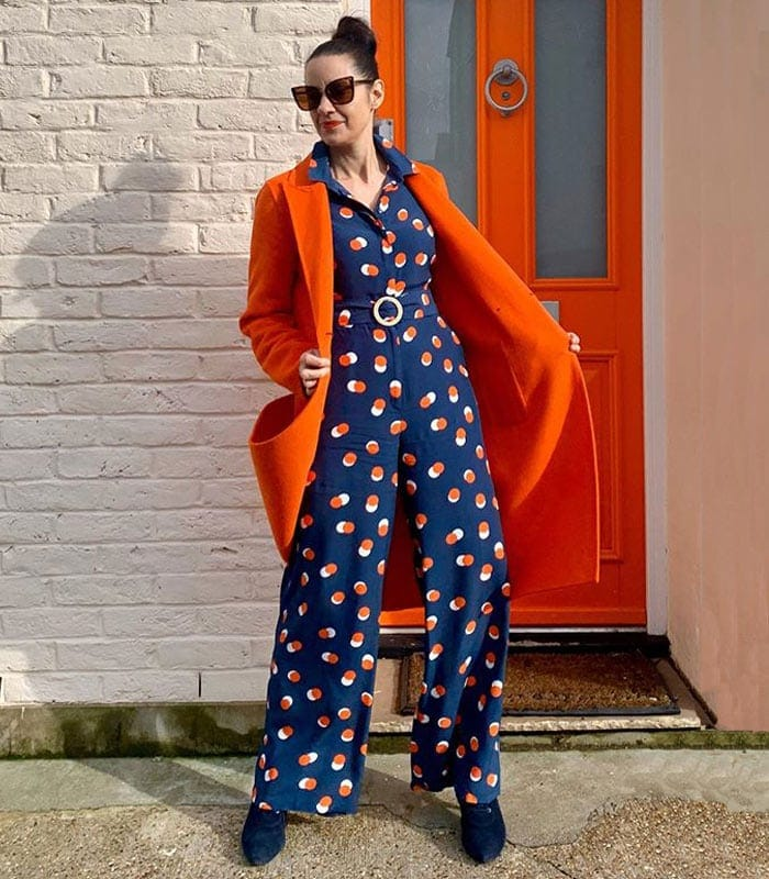 Katie wears a navy and orange outfit | 40plusstyle.com