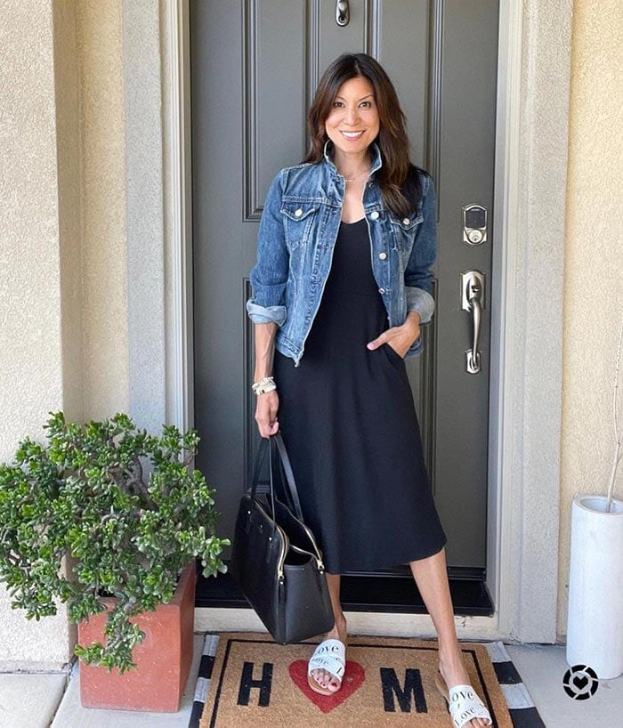A denim jacket and black dress outfit   40plusstyle.com