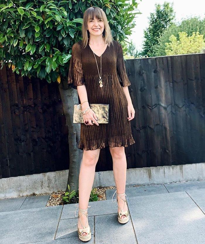 Lizzi wearing a metallic party dress   40plusstyle.com