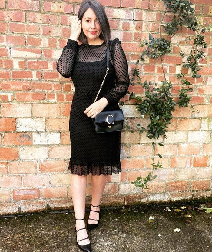 Nikki wearing a black polka dot cocktail dress | 40plusstyle.com