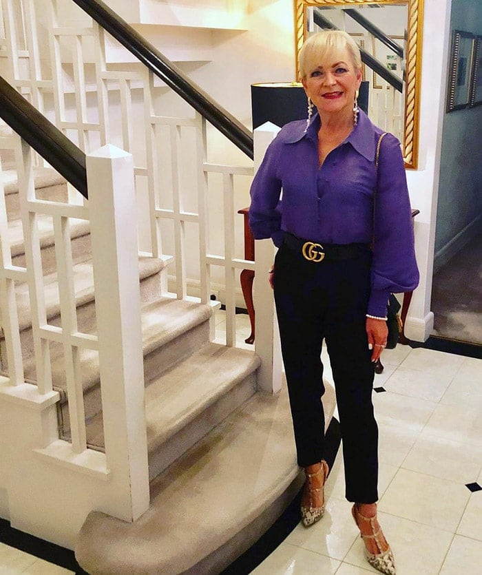 Purple outfits - Marina wearing a purple blouse and black pants | 40plusstyle.com
