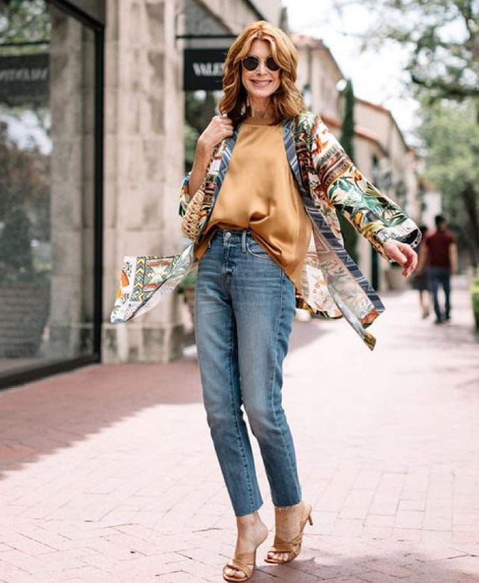 What to wear to a bar - Cathy in jeans and a silk top   40plusstyle.com