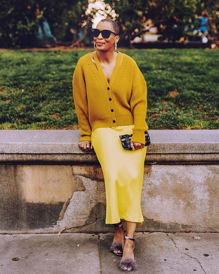 Kim in a yellow skirt and cardigan | 40plusstyle.com