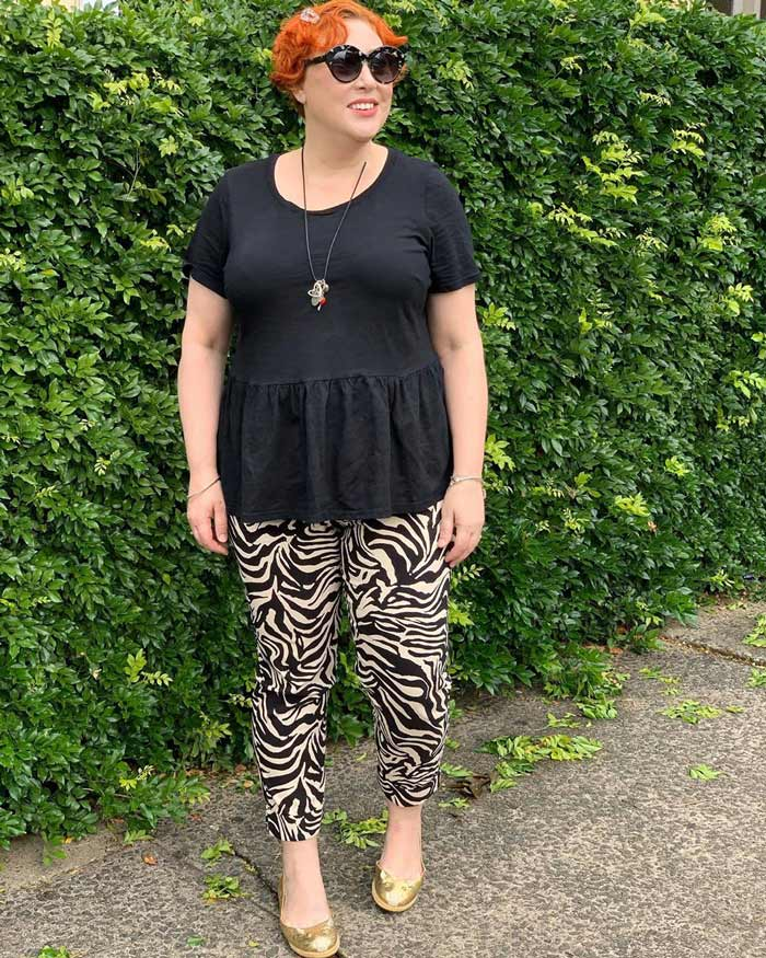 the best t shirts for women - Kim wears a peplum tee | 40plusstyle.com