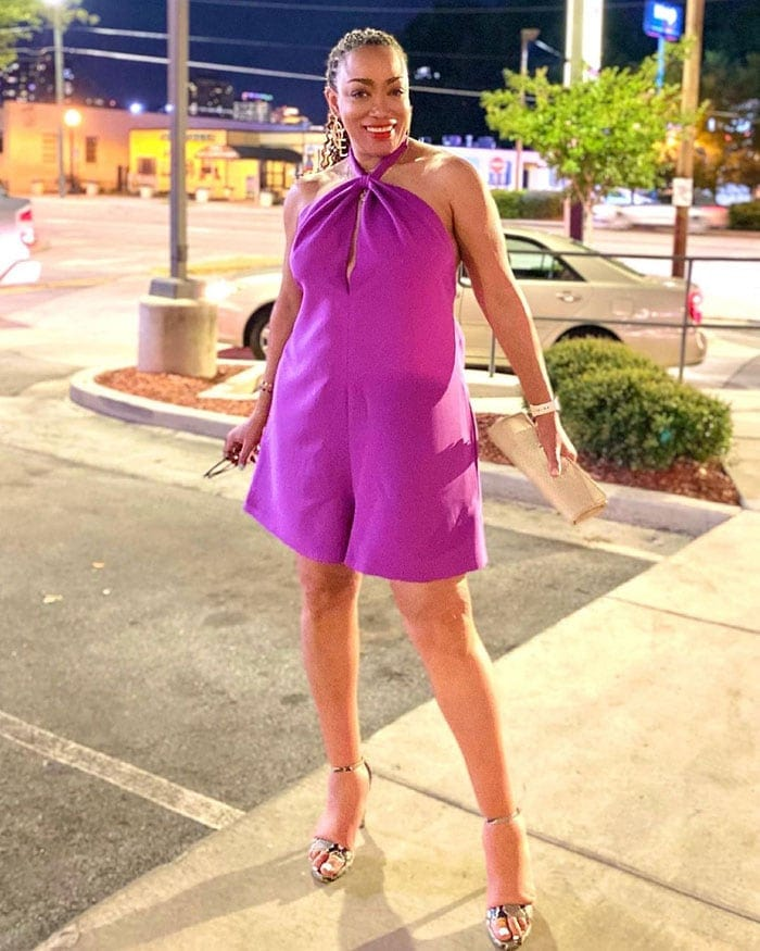 Vegas outfits - Erica in a purple romper and heels   40plusstyle.com