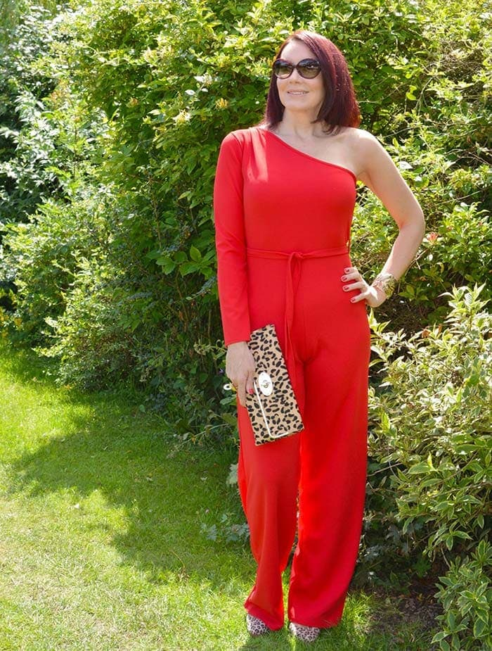 What to wear for Christmas party season - Emma in a red jumpsuit   40plusstyle.com
