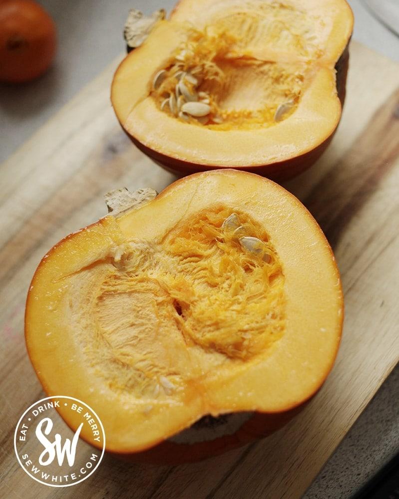 cut open pumpkin showing the flesh