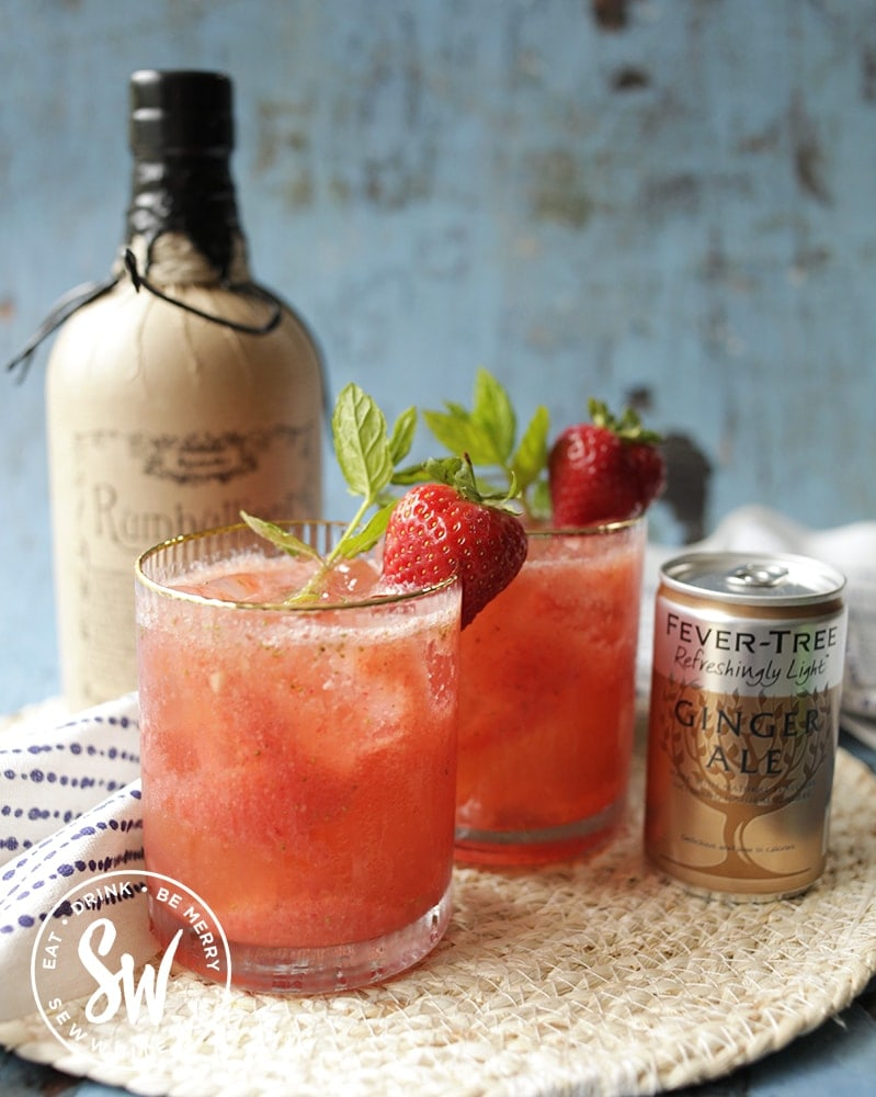 strawberry rum cocktail with mint and strawberries and Rumbullion rum