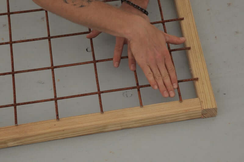 SETTING IN THE HOG WIRE DECK RAILING