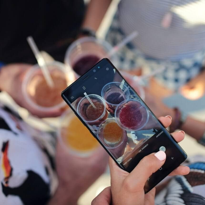 photo of a phone taking a picture used in blog post new features added to instagram in 2018