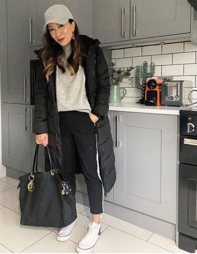 Warmest coats for women - Abi wears a black puffer coat   40plusstyle.com