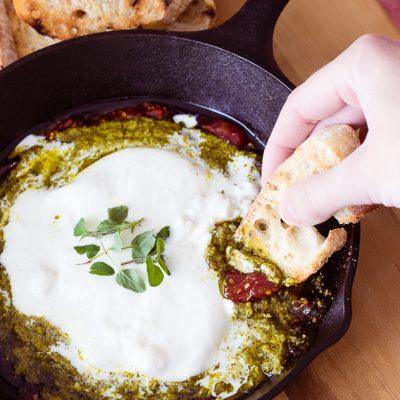 Burrata Crostini with Tomato Jam and Pesto