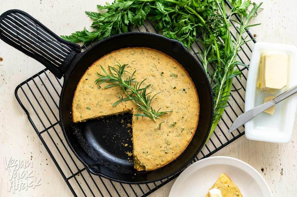 Image of Carrot Top Herb Cornbread on a cooling rack with slice cut out