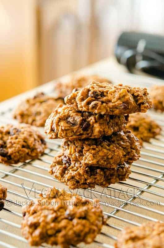 Persimmon Oatmeal Cookies stacked on one another on a cooling rack