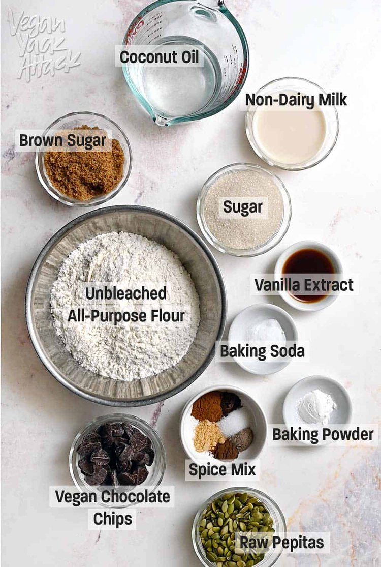 Overhead image of ingredients for chocolate chai cookies in dishes with text labels