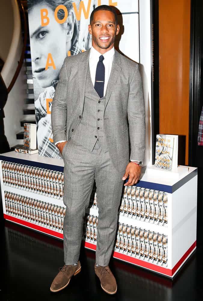 Victor Cruz wearing a three-piece suit