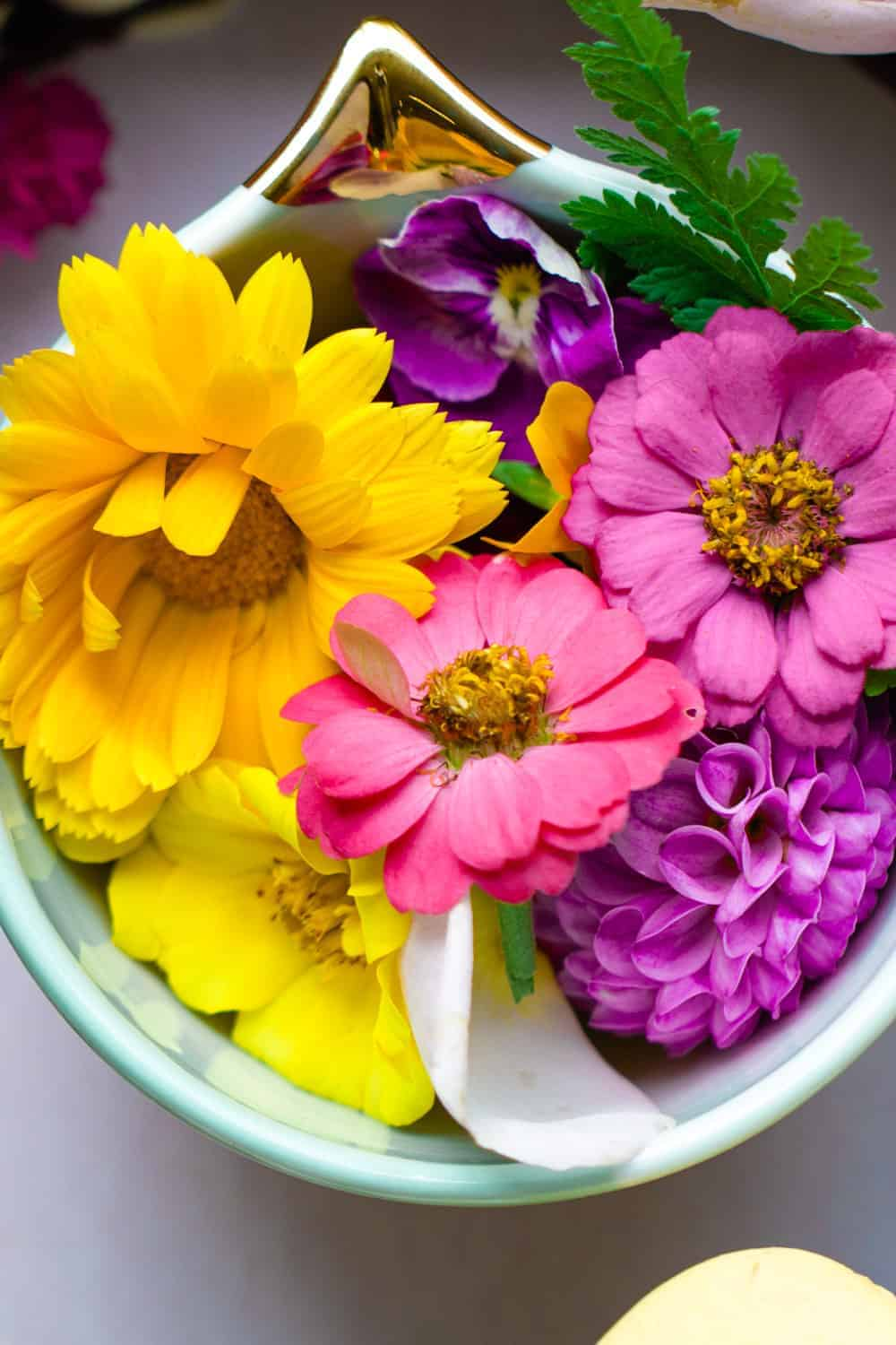 A small bowl of fresh edible flowers