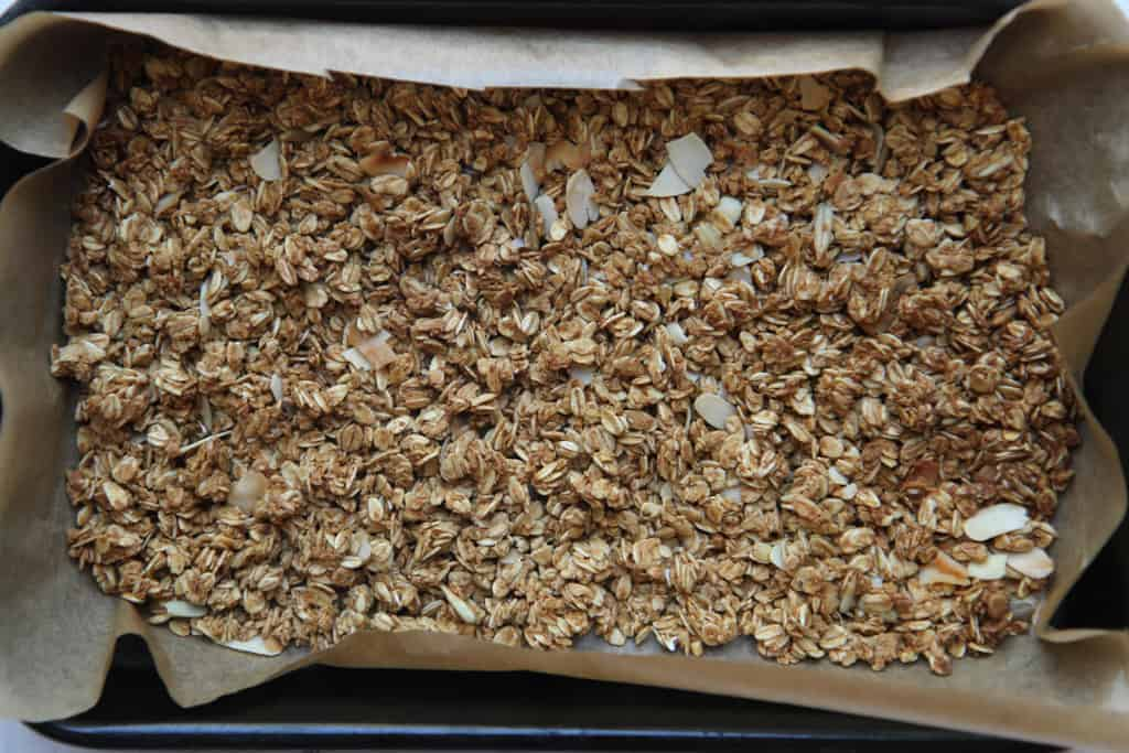 A baking tray covered with nut granola