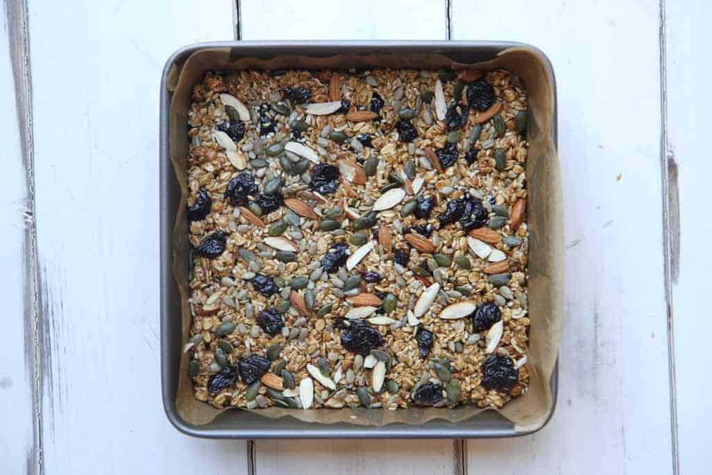 A square tin with granola bar mixture