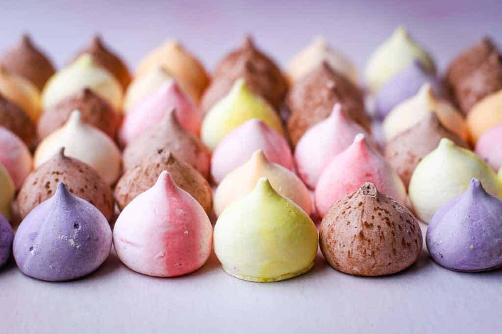 Rows of different coloured meringue drops