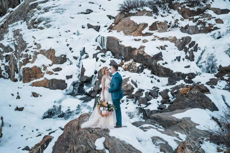 Bride and Groom Hugging Breckenridge Elopement Guide and Spots
