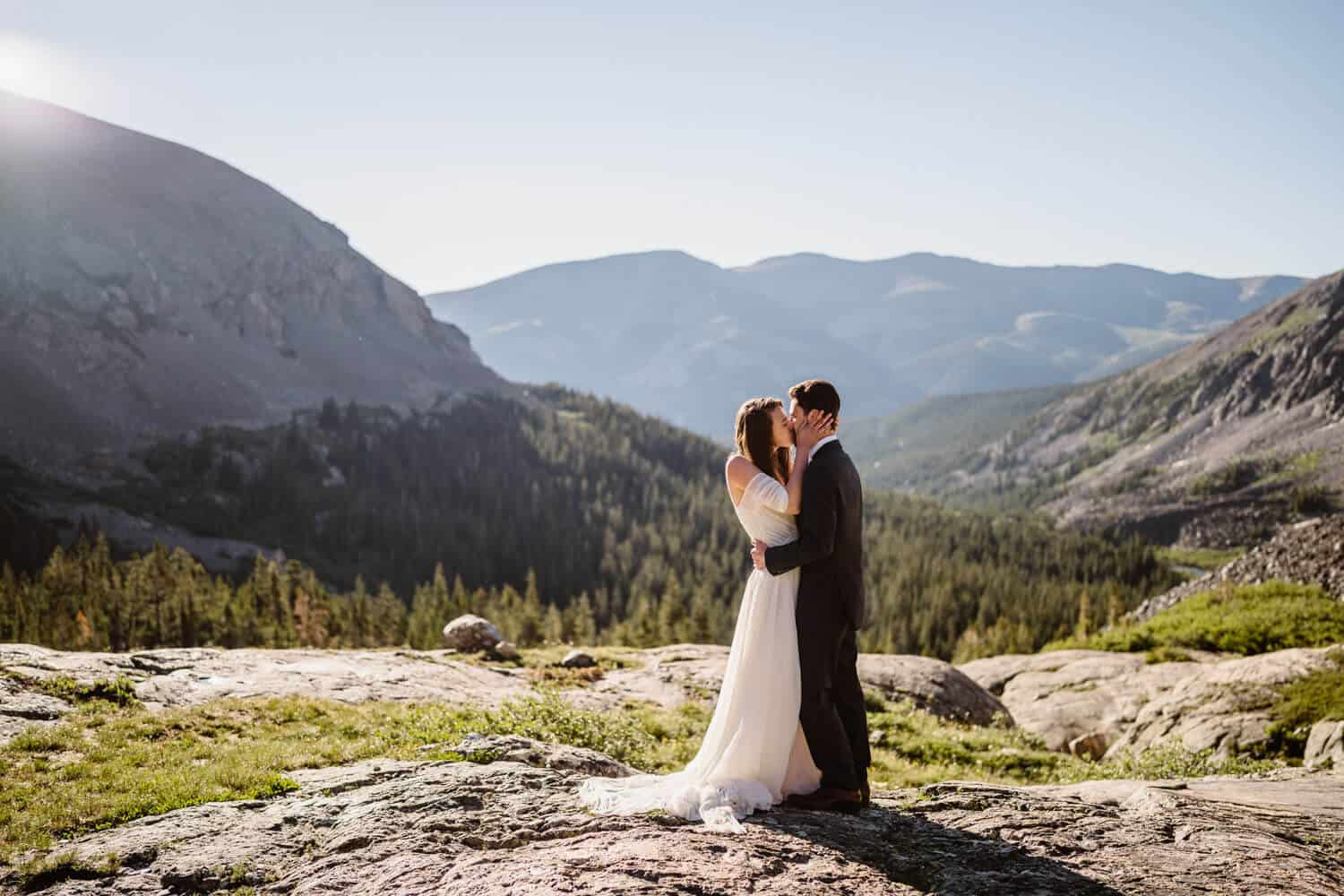 Bride and Groom Kissing Breckenridge Elopement Guide and Spots