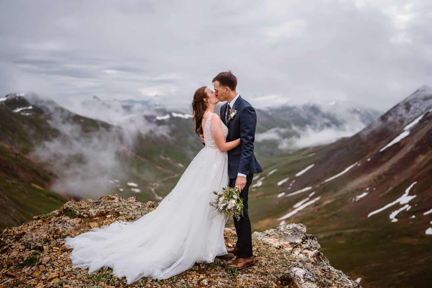 Bride and Groom Kissing Colorado Mountain Elopement Packages