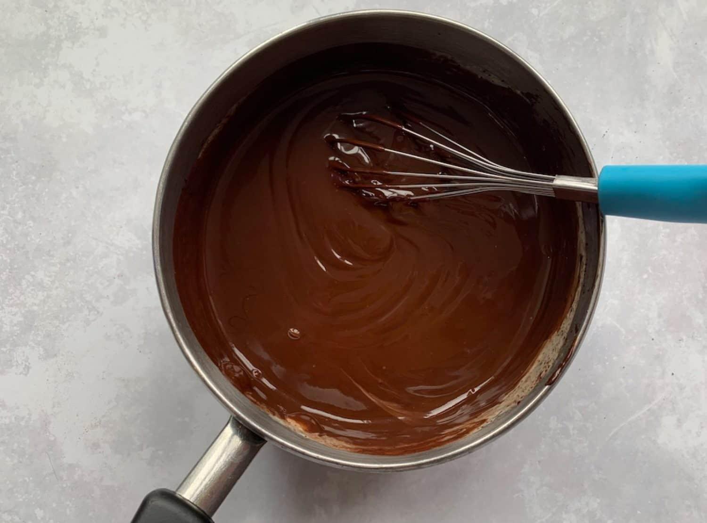 Chocolate ganache in a saucepan.