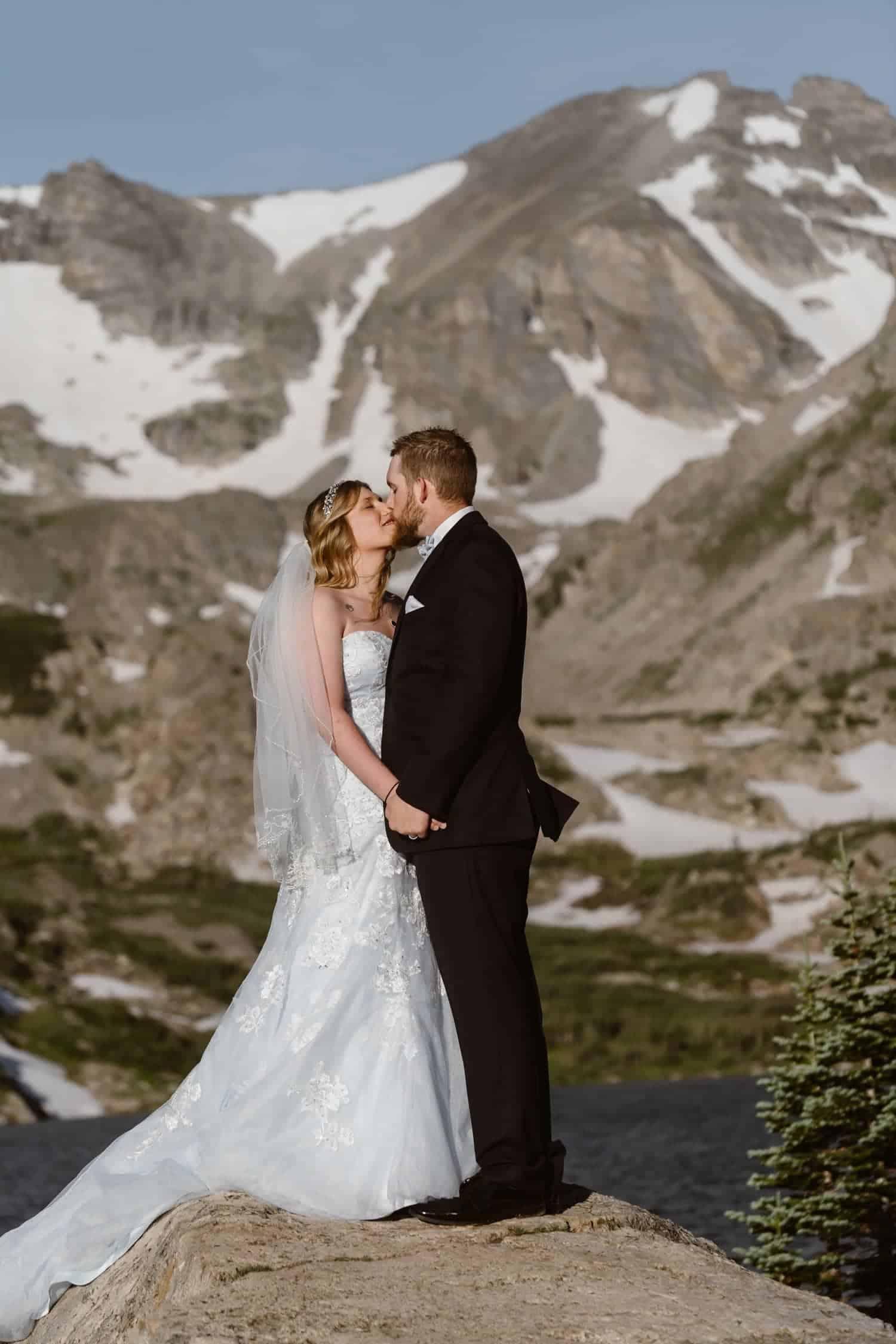 Bride and Groom Kissing at Lake  Colorado Adventure Elopement